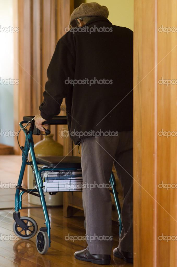 Elderly man use a walker (walking frame) — Stock Photo © lucidwaters ...