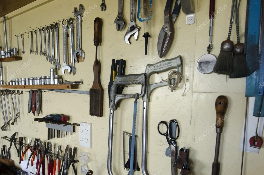 Do it yourself tools stock photo lucidwaters 16276809 assortment of do it yourself tools hanging in a wooden cupboard against a wall photo by lucidwaters solutioingenieria Gallery