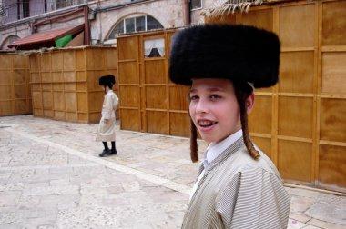 JERUSALEM - OCT 20:Young ultra orthodox Jewish men during Sukkot Jewish holiday in Mea Shearim on October 20 2005 Jerusalem, Israel. stock vector