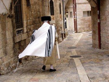 JERUSALEM - OCT 20:Orthodox Jewish man walks in Mea Shearim on October 20 2005 Jerusalem, Israel.It's one of the oldest Jewish neighborhoods in Jerusalem populated mainly by Haredi Jews. stock vector