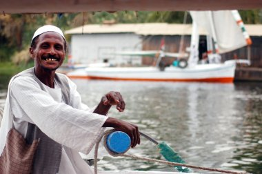 Felucca sailor sails on the Nile river