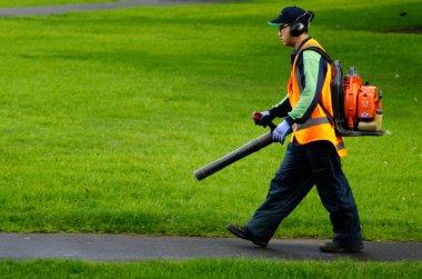 Landscaper operating petrol Leaf Blower