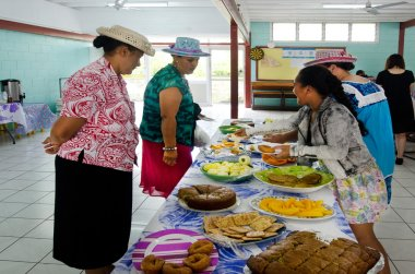Cook Islands woman serve traditional food on sunday morning tea