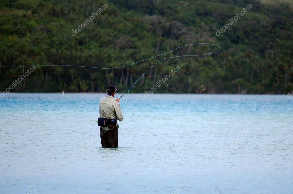 Casting for bonefish in Aitutaki Lagoon Cook Islands