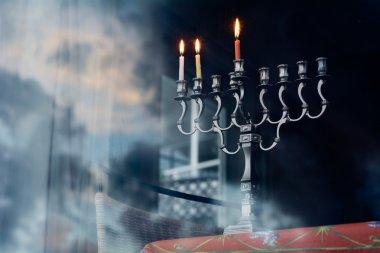 Hanukkah menorah on the second day of Hanukkah
