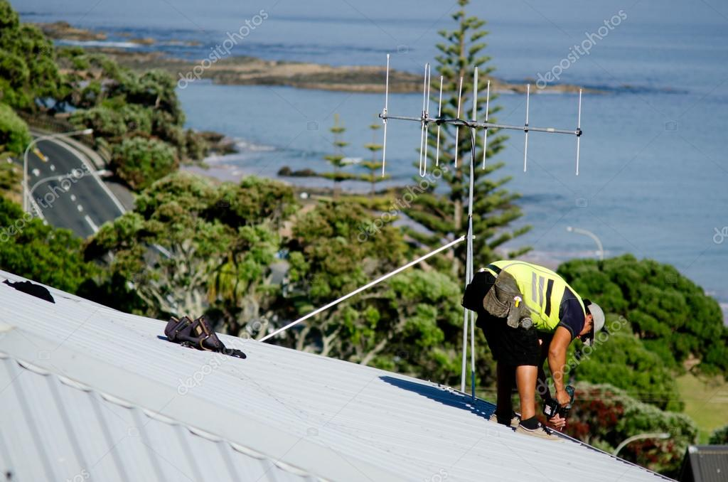 Roofer fixing a leaking roof