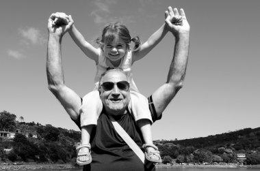 Granddad carry his grandchild