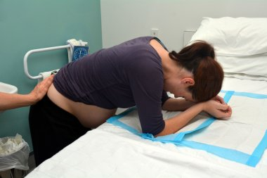 Pregnant woman having contraction