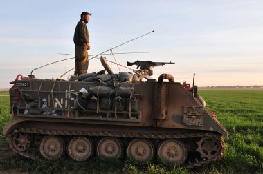 Israeli soldier on armed vehicle