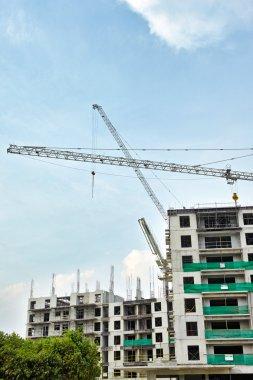 Block of apartments building in construction progress stock vector