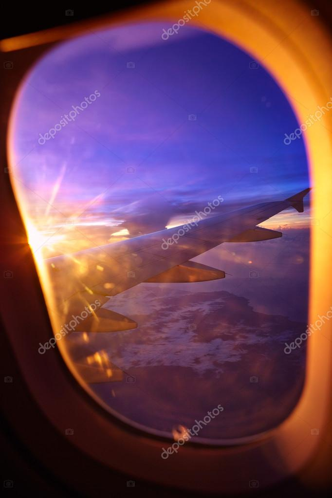 airplane window view sunset