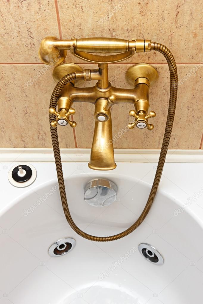 Vintage bathtub faucet and ceramic tiles in background — Stock