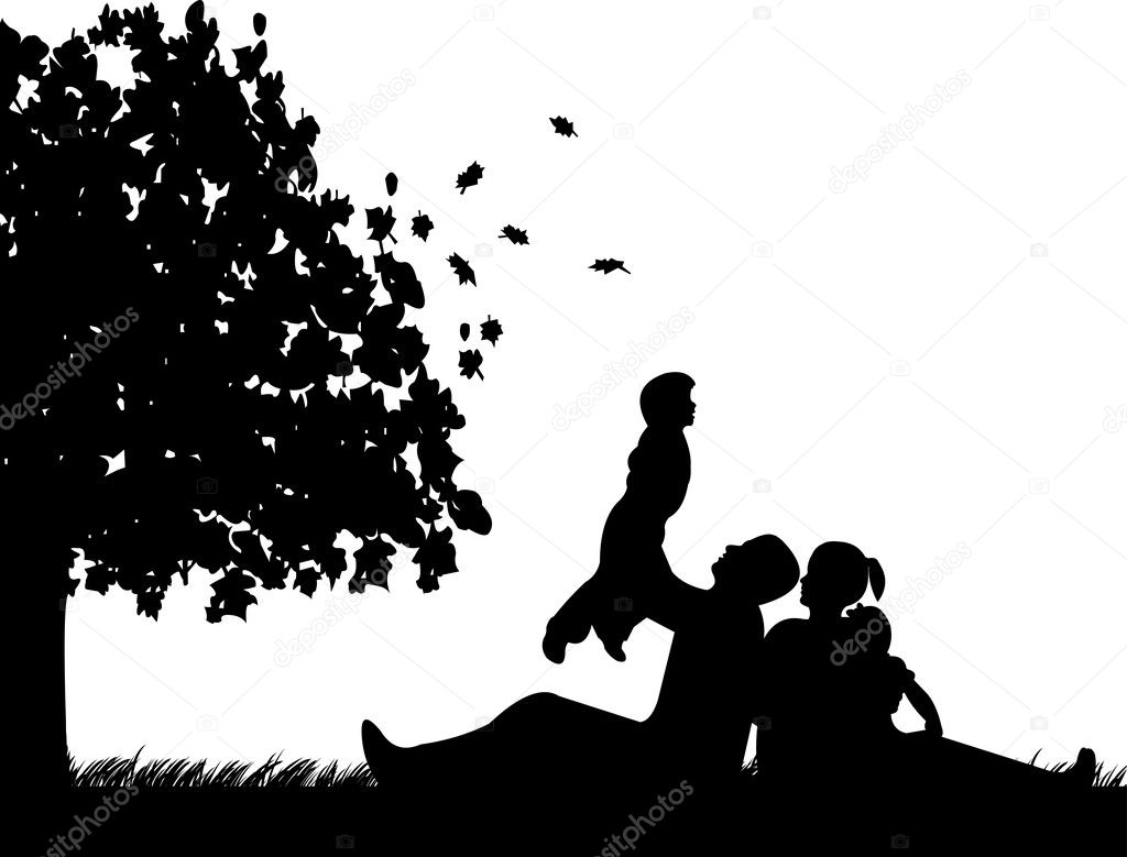 Family picnic in park in autumn or fall under the tree silhouette