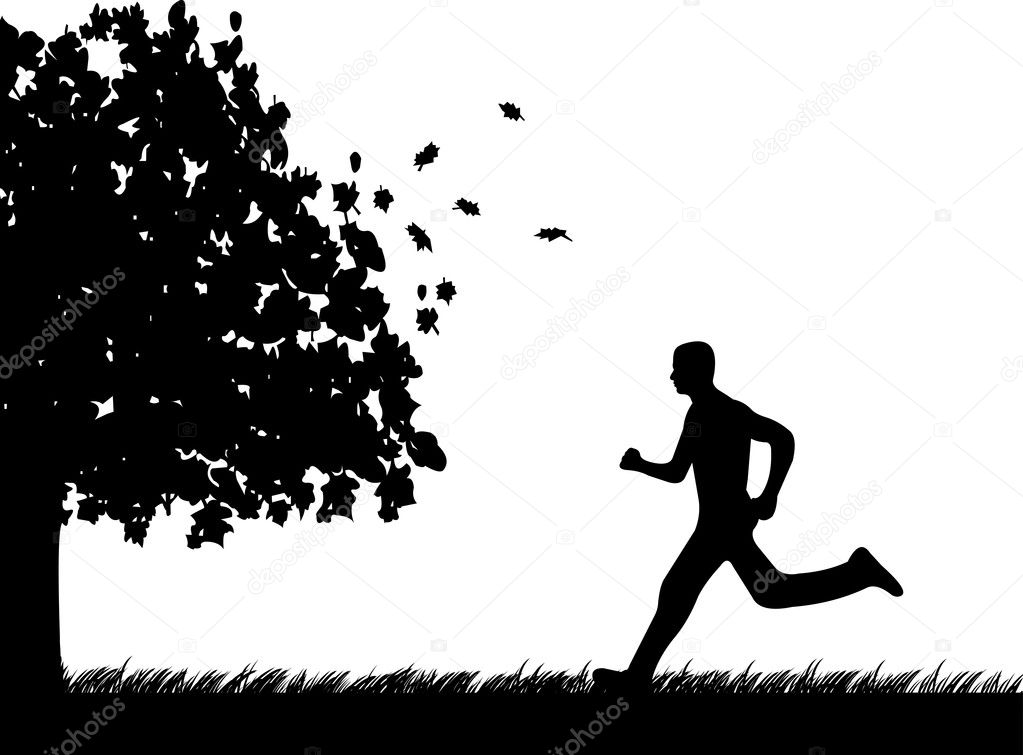 Man running in park in autumn or fall silhouette,