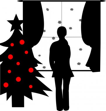 Girl watching through a window and waiting for someone at Christmas time silhouette