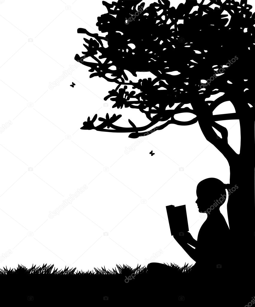 Girl reading a book under the tree in spring in park or garden silhouette