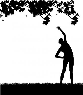 Pretty girl exercising flexibility with stretching posture in spring outdoors in park silhouette