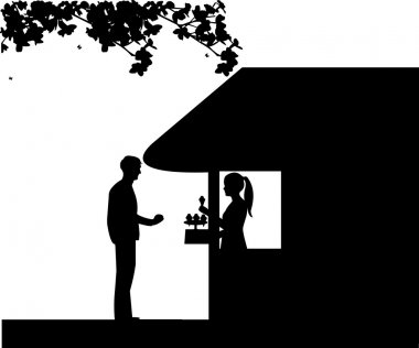 Silhouette of a man who buys ice cream at an ice cream shop