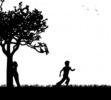 Children playing hide and seek in the park silhouette