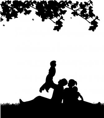 Family picnic in park in spring under the tree silhouette