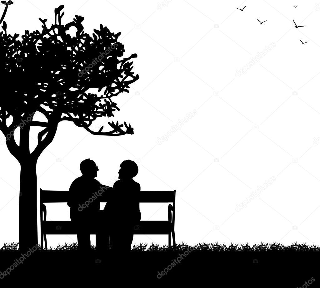 Lovely retired elderly couple sitting on bench in park or garden