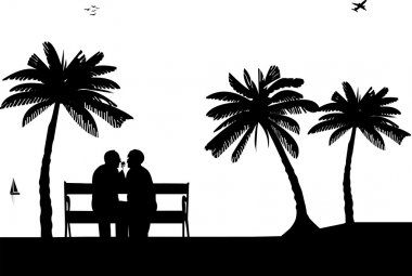 Lovely retired elderly couple sitting on bench on the beach with flower