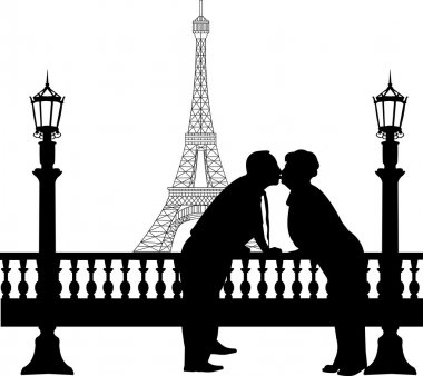 Lovely retired elderly couple kissing in front of Eiffel tower in Paris