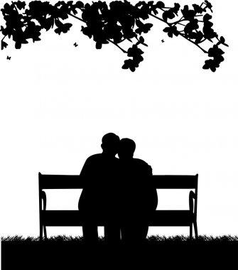 Lovely retired elderly couple sitting on bench in garden or yard