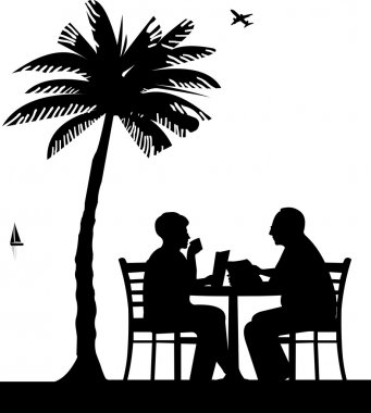 Lovely retired elderly couple drinking coffee and reading a newspaper on the beach under palm tree