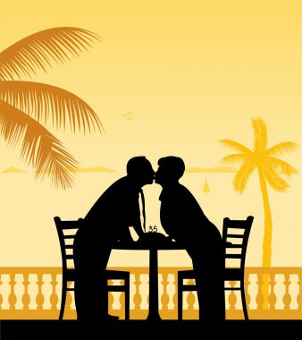 Lovely retired elderly couple celebrate their anniversary on the beach under palm tree