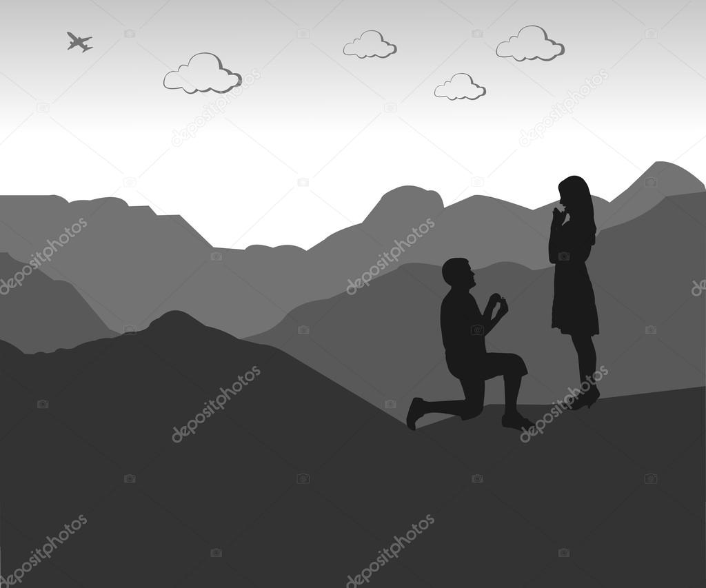 Romantic proposal on top of the mountain