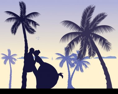 Wedding couple between the palms on the beach silhouette