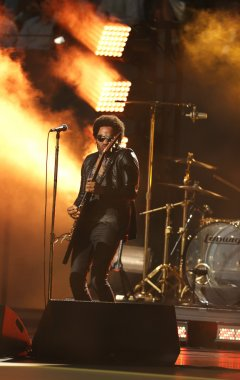 Four times Grammy Award winner Lenny Kravitz performed at the US Open 2013 opening night ceremony