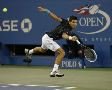 Professional tennis player Novak Djokovic during quarterfinal match at US Open 2013 against Mikhail Youzhny
