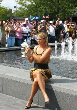 US Open 2006 champion Maria Sharapova holds US Open trophy in the front of the crowd after she won the ladies singles final