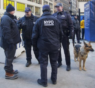 NYPD counter terrorism officers and NYPD transit bureau K-9 police officer with K-9 dog providing security on Broadway during Super Bowl XLVIII week