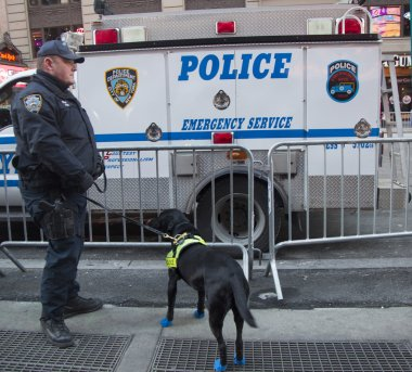 NYPD transit bureau K-9 police officer and K-9 dog providing security on Times Square during Super Bowl XLVIII week in Manhattan
