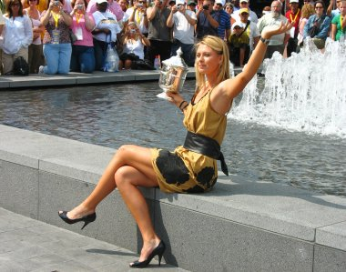 US Open 2006 champion Maria Sharapova holds US Open trophy in the front of the crowd