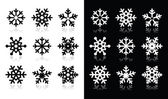 Fotografie sněhové vločky ikony se stínem na černé a bílé pozadí