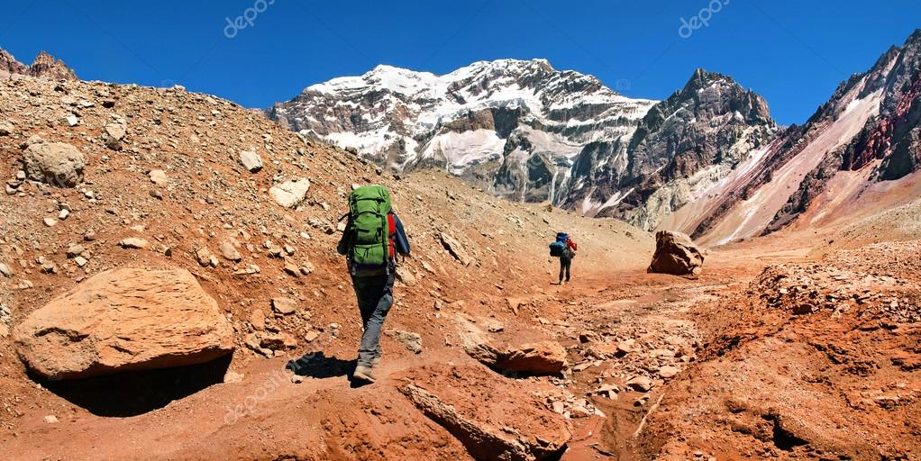 Hikers on their way to Aconcagua as seen in the background, Aconcagua National Park, Argentina, South America
