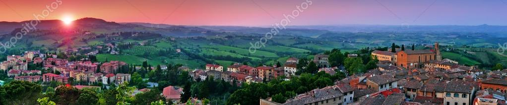 Panoramic view of beautiful landscape with the medieval city of San Gimignano at sunset in Tuscany, province of Siena, Italy