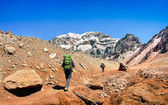 Hikers on their way to Aconcagua as seen in the background in Argentina, South America