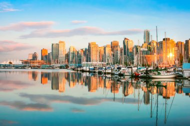 Beautiful view of Vancouver skyline with harbor at sunset, BC, Canada