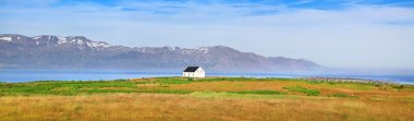 Panoramic view of beautiful landscape with old house in Iceland