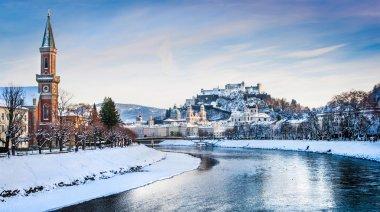 Salzburg skyline panorama with Festung Hohensalzburg and river Salzach in winter, Salzburger Land, Austria