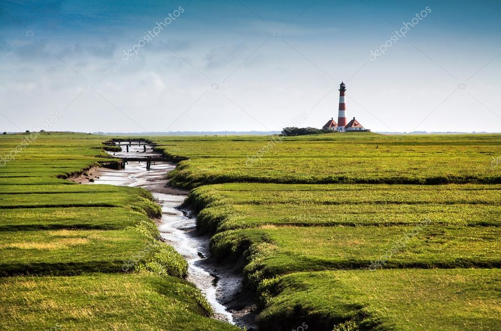 Beautiful landscape with famous Westerheversand lighthouse in the background at North Sea in Nordfriesland, Schleswig-Holstein, Germany