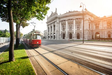 Famous Wiener Ringstrasse with Burgtheater and traditional tram in Vienna, Austria