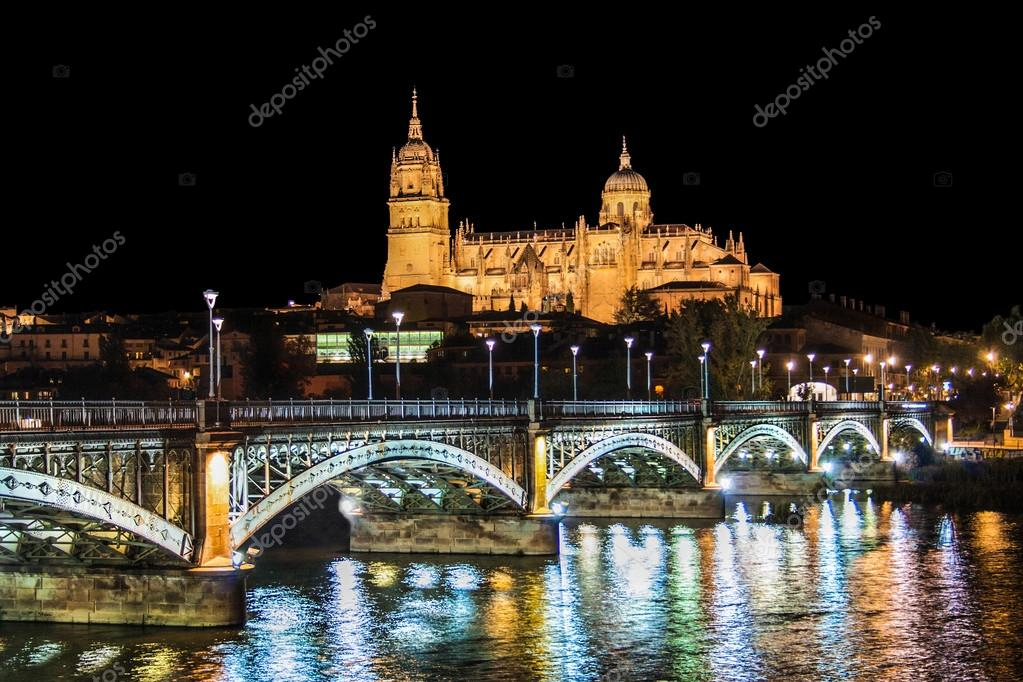 Фотообои Beautiful view of the historic city of Salamanca with New Cathedral and Enrique Esteban bridge at night, Castilla y Leon region, Spain