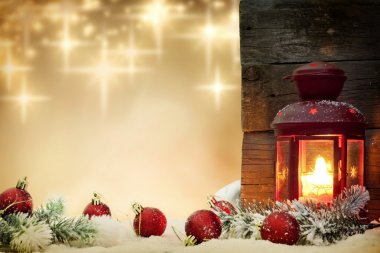 Christmas baubles with lantern and stars background concept