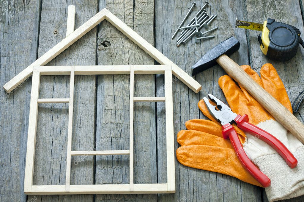 House construction renovation abstract background and tools